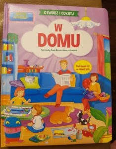 """Okładka książki """"W domu"""""""